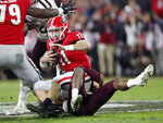 Georgia quarterback Jake Fromm (11) is sacked by Texas A&M linebacker Aaron Hansford (33) in the second half of an NCAA college football game Saturday, Nov. 23, 2019, in Athens, Ga. Georgia won 19-13. (AP Photo/John Bazemore)