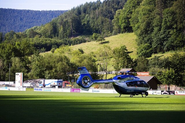 A police helicopter stands on a sports field in Oppenau, southern Germany, Tuesday, July 14, 2020. Authorities in Germany say they have deployed hundreds of police in the hunt for a 31-year-old man who disarmed four officers at gunpoint on Sunday, July 12, 2020. (Philipp von Ditfurth/dpa via AP)/dpa via AP)
