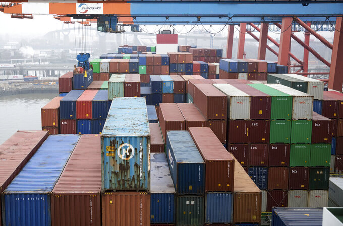 FILE - In this March 22, 2019 file photo containers are unloaded by a freighter at the Eurokai terminal (Eurogate) in the port of Hamburg, Germany. (Christian Charisius/dpa via AP, file)