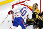 Montreal Canadiens right wing Joel Armia (40) collides with Boston Bruins goaltender Tuukka Rask, right, during the first period of an NHL hockey game in Boston, Wednesday, Feb. 12, 2020. (AP Photo/Charles Krupa)