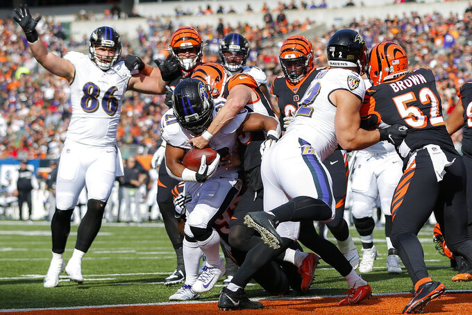 Baltimore Ravens running back Mark Ingram (21) scores a touchdown during the first half of NFL football game against the Cincinnati Bengals, Sunday, Nov. 10, 2019, in Cincinnati. (AP Photo/Frank Victores)