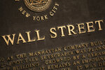 FILE - In this May 26, 2020 file photo, a historic marker for Wall Street is shown in New York's financial district. Stocks are off to a mixed start on Wall Street Tuesday, Sept. 29 as the market cooled off following a rally the day before and as investors waited for the presidential debate between former Vice President Joe Biden and President Donald Trump. Banks and industrial companies had some of the biggest losses shortly after the opening bell Tuesday, while several big technology and communications companies were higher. (AP Photo/Mark Lennihan, File)