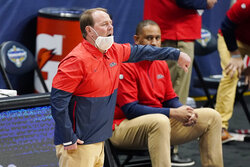 Mississippi head coach Kermit Davis directs his players in the first half of an NCAA college basketball game against South Carolina in the Southeastern Conference Tournament Thursday, March 11, 2021, in Nashville, Tenn. (AP Photo/Mark Humphrey)
