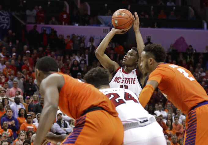 North Carolina State's Markell Johnson (11) shoots the game-winning free throw in the closing seconds of the second half of an NCAA college basketball game against Clemson in the Atlantic Coast Conference tournament in Charlotte, N.C., Wednesday, March 13, 2019. (AP Photo/Chuck Burton)