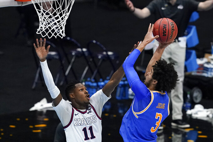 UCLA guard Johnny Juzang (3) shoots over Gonzaga guard Joel Ayayi (11) during the first half of a men's Final Four NCAA college basketball tournament semifinal game, Saturday, April 3, 2021, at Lucas Oil Stadium in Indianapolis. (AP Photo/Darron Cummings)