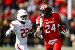 Maryland running back Ty Johnson, right, rushes for a first down past Rutgers defensive back Damon Hayes in the first half of an NCAA college football game, Saturday, Oct. 13, 2018, in College Park, Md. Maryland won 34-7. (AP Photo/Patrick Semansky)