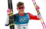Johannes Hoesflot Klaebo, of Norway, celebrates after winning the men's cross-country skiing sprint classic at the 2018 Winter Olympics in Pyeongchang, South Korea, Tuesday, Feb. 13, 2018. (AP Photo/Matthias Schrader)