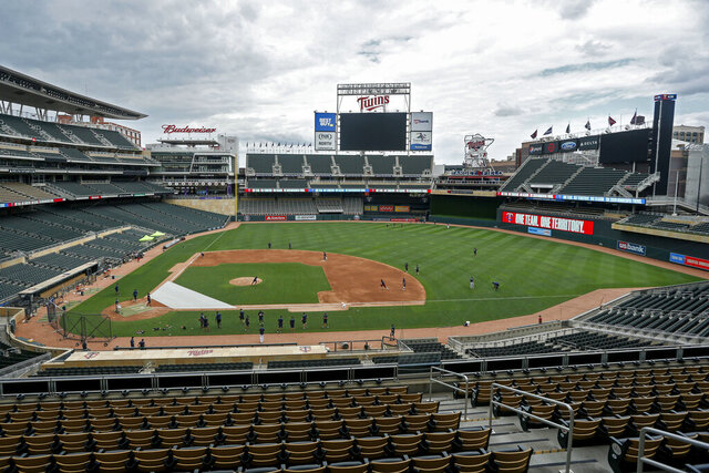 The Minnesota Twins run drills on Target Field at a baseball camp iMonday, July 6, 2020, in Minneapolis. (AP Photo/Bruce Kluckhohn)