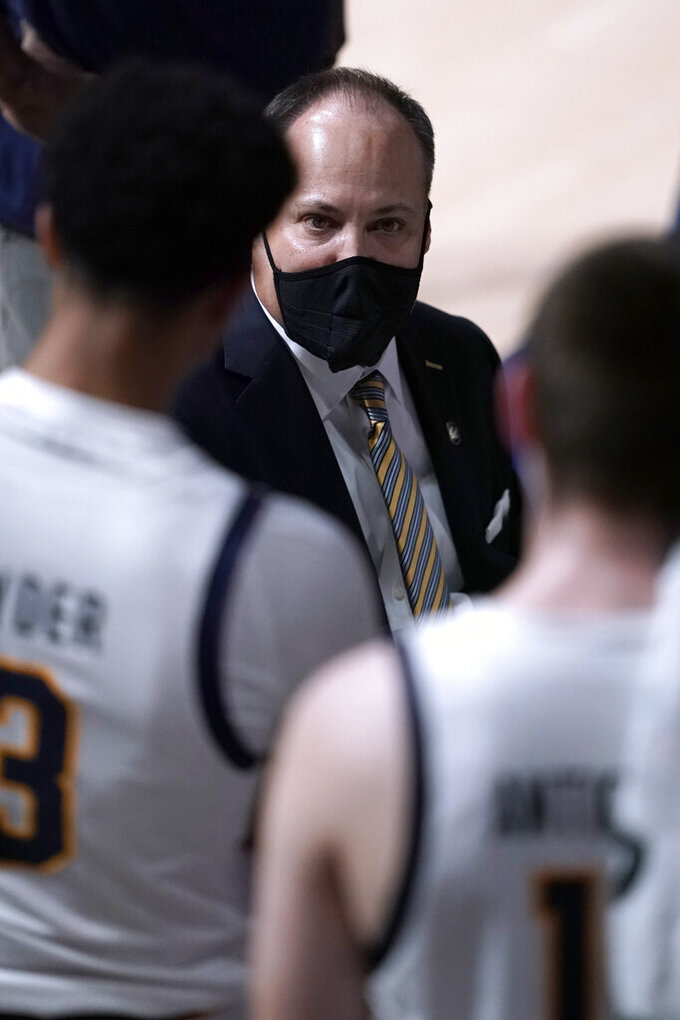 California head coach Mark Fox talks to his players during a timeout against Washington State in the first half of an NCAA college basketball game, Thursday, Jan. 7, 2021, in Berkeley, Calif. (AP Photo/Tony Avelar)