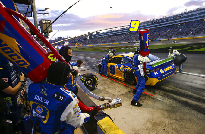 Chase Elliott (9) pits during a NASCAR Cup Series auto race at the Las Vegas Motor Speedway on Sunday, Sept. 15, 2019. (AP Photo/Chase Stevens)