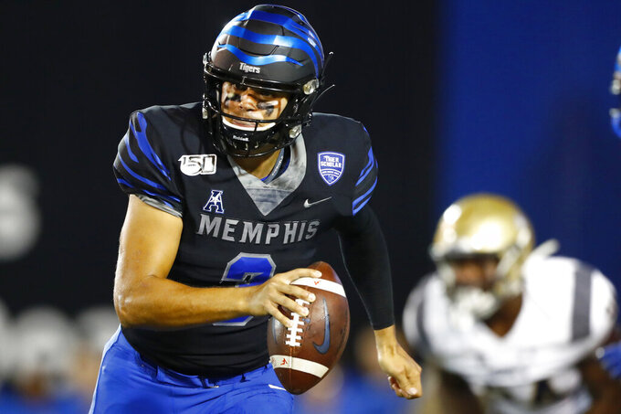 FILE - In this Sept. 26, 2019, file photo, Memphis quarterback Brady White scrambles out of the pocket during an NCAA college football game against Navy in Memphis Tenn. White has thrown three touchdown passes in each of Memphis' last three games. They play at Temple on Saturday. (Joe Rondone/The Commercial Appeal via AP, File)