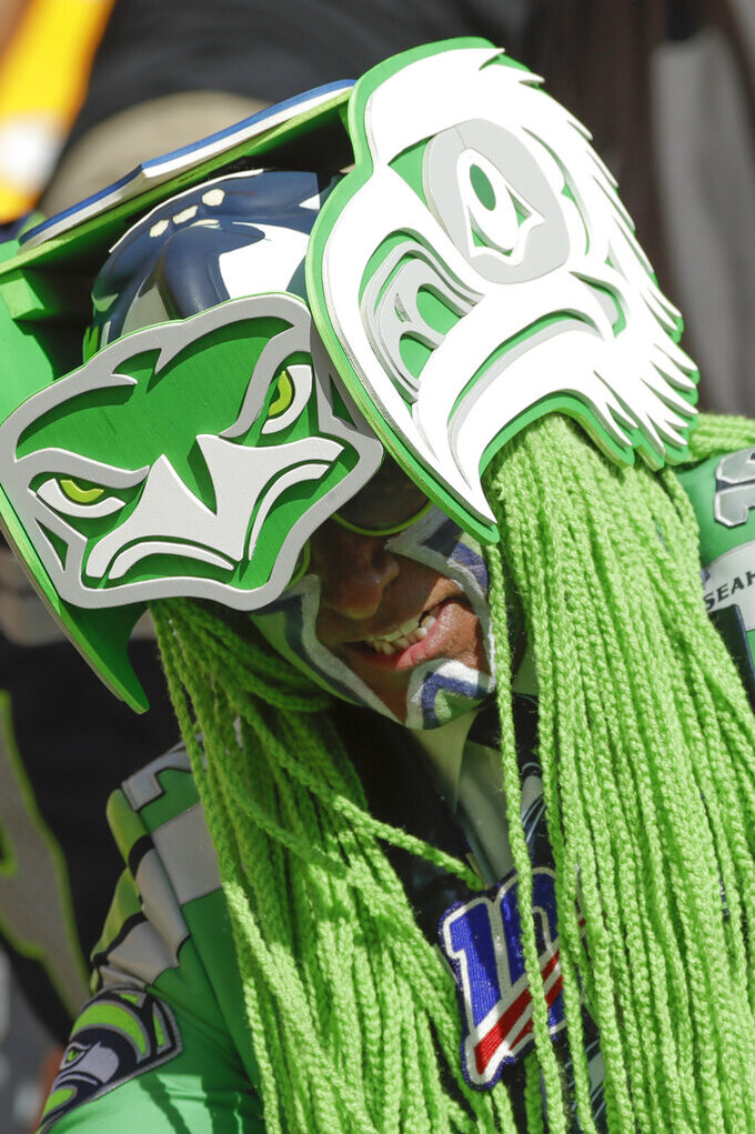 Seattle Seahawks fan Wallace Watts wears his Seahawks outfit in the stands before an NFL football game between the Pittsburgh Steelers and the Seattle Seahawks, Sunday, Sept. 15, 2019, in Pittsburgh. (AP Photo/Gene J. Puskar)