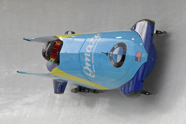 Driver Kaillie Humphries, and brakeman Lauren Gibbs of the United States take a turn during the first run of the women's bobsled World Cup race, in Lake Placid, N.Y., on Saturday, Dec. 14, 2019. (AP Photo/Hans Pennink)
