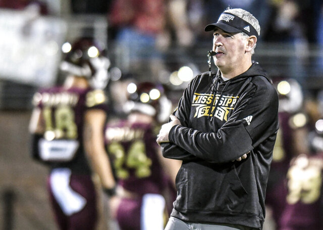Mississippi State head coach Joe Moorhead watches the players warm up before an NCAA college football game against Mississippi in Starkville, Miss., Thursday, Nov. 28, 2019. (Bruce Newman/The Oxford Eagle via AP)