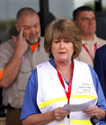 Intercontinental Terminals Company public information officer Alice Richardson reads a statement during a news conference Saturday, March 23, 2019, in Pasadena, Texas. The efforts to clean up the Texas industrial plant that burned for several days this week were hamstrung Friday by a briefly reignited fire and a breach that led to chemicals spilling into the nearby Houston Ship Channel. (AP Photo/David J. Phillip)