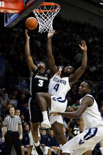 Providence's David Duke (3) shoots against Villanova's Eric Paschall (4) during the first half of an NCAA college basketball game, Wednesday, Feb. 13, 2019, in Villanova, Pa. (AP Photo/Matt Slocum)