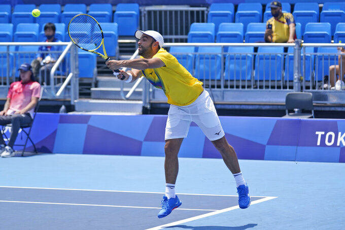 Juan-Sebastian Cabal, of Colombia, plays in a doubles match during the quarterfinals of the tennis competition at the 2020 Summer Olympics, Wednesday, July 28, 2021, in Tokyo, Japan. (AP Photo/Seth Wenig)