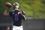 Baltimore Ravens quarterback Lamar Jackson works out during an NFL football camp practice, Monday, Aug. 17, 2020, in Owings Mills, Md. (AP Photo/Julio Cortez)