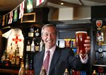"FILE - In this Friday, May 23, 2014 file photo, Nigel Farage, leader of Britain's United Kingdom Independence Party (UKIP) poses for the media with a pint of beer in South Benfleet, England.  Farage, the self-declared ""pantomime villain"" of Brexit, told the Associated Press Tuesday Jan. 14, 2020, he is leaving the European Union's parliament in Strasbourg later this week with a sense of mission accomplished.(AP Photo/Lefteris Pitarakis, File)"