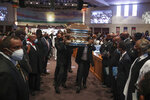 Pallbearers recess out of the church with the casket following the funeral for George Floyd on Tuesday, June 9, 2020, at The Fountain of Praise church in Houston. (Godofredo A. Vásquez/Houston Chronicle via AP, Pool)