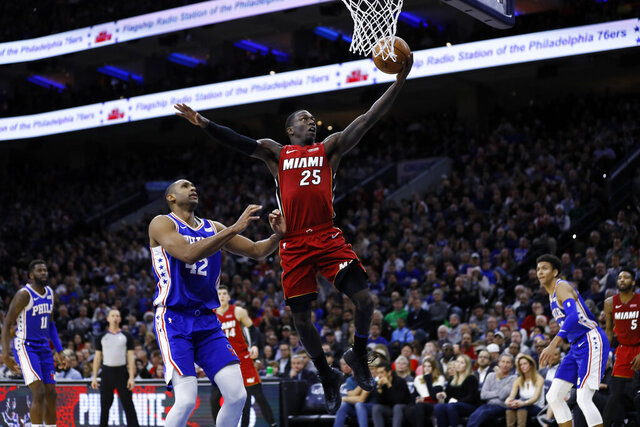 Miami Heat's Kendrick Nunn (25) goes up for a shot past Philadelphia 76ers' Al Horford (42) during the first half of an NBA basketball game, Wednesday, Dec. 18, 2019, in Philadelphia. (AP Photo/Matt Slocum)