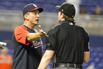 Washington Nationals bench coach Tim Bogar, left, argues a call with home plate umpire Adam Beck during the 10th inning of a baseball game against the Miami Marlins, Monday, Sept. 20, 2021, in Miami. (AP Photo/Marta Lavandier)