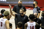 Alabama head coach Nate Oats, center, works with his team during the second half of an NCAA college basketball game against Mississippi State, Saturday, Jan. 23, 2021, in Tuscaloosa, Ala. (AP Photo/Vasha Hunt)