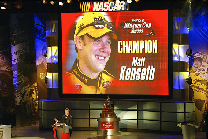 FILE - In this Dec. 5, 2003, file photo, NASCAR Winston Cup champion Matt Kenseth makes his acceptance speech during awards ceremonies in New York. Former NASCAR champion Matt Kenseth will once again come out of retirement to compete for Chip Ganassi Racing as the replacement for fired driver Kyle Larson. The team instead announced Monday, Aril 27, 2020, it will go with two-time Daytona 500 winner Kenseth for the remainder of the season. (Tim Parks/News and Sentinel via AP, File)