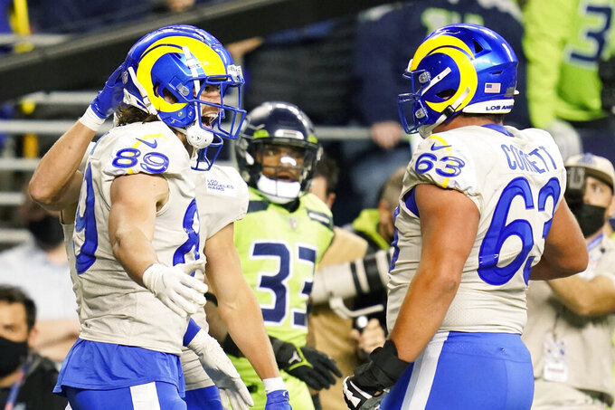 Los Angeles Rams tight end Tyler Higbee (89) and guard Austin Corbett (63) celebrate after Higbee scored a touchdown against the Seattle Seahawks during the second half of an NFL football game, Thursday, Oct. 7, 2021, in Seattle. (AP Photo/Elaine Thompson)