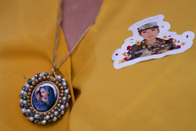 FILE - In this July 30, 2020, file photo, Slain Army Spc. Vanessa Guillen's mother Gloria Guillen wears a sticker with her daughters image and a Blessed Virgin Mary necklace during a news conference on the National Mall in front of Capitol Hill in Washington. Army leaders are delaying the planned transfer of the Fort Hood commander, as a team of independent investigators heads to the base to determine whether leadership failures contributed to the murder of a soldier earlier this year, and several other deaths. (AP Photo/Carolyn Kaster, File)