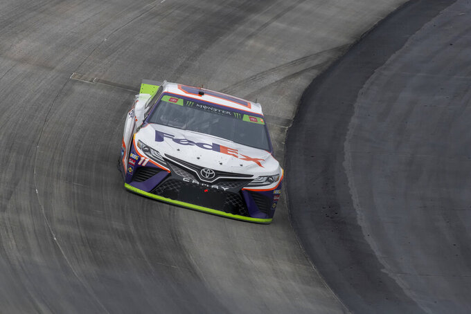Denny Hamlin competes at the Drydene 400 - Monster Energy NASCAR Cup Series playoff auto race, Sunday, Oct. 6, 2019, at Dover International Speedway in Dover, Del. (AP Photo/Jason Minto)