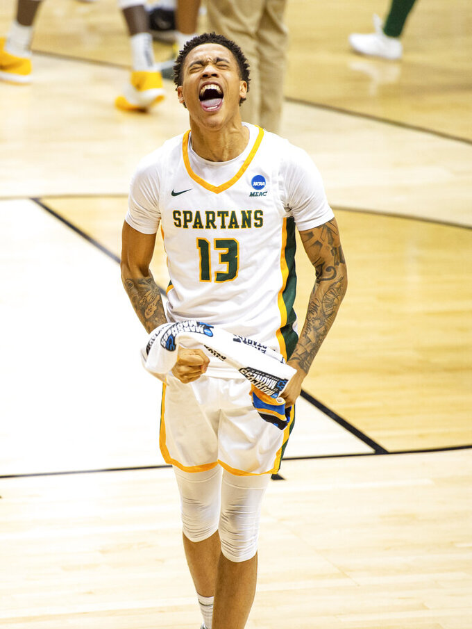 Norfolk State guard Daryl Anderson (13) reacts after his team's defeat of Appalachian State in a First Four game in the NCAA men's college basketball tournament, Thursday, March 18, 2021, in Bloomington, Ind. (AP Photo/Doug McSchooler)