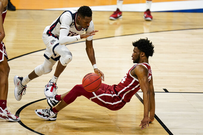 Gonzaga guard Joel Ayayi (11) is fouled by Oklahoma guard Elijah Harkless (24) in the first half of a second-round game in the NCAA men's college basketball tournament at Hinkle Fieldhouse in Indianapolis, Monday, March 22, 2021. (AP Photo/Michael Conroy)