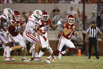 FILE - In this Saturday, Sept. 7, 2019 file photo, Oklahoma quarterback Spencer Rattler (7) carries in the fourth quarter of an NCAA college football game against South Dakota, in Norman, Okla. Rattler is competing with Tanner Mordecai for the starting spot. (AP Photo/Sue Ogrocki, File)