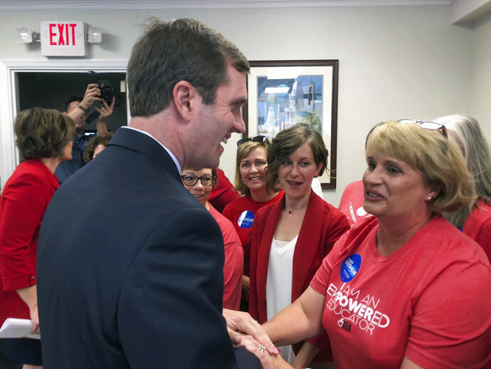 Democratic gubernatorial nominee Andy Beshear meets with supporters on Wednesday, Sept. 4, 2019, in Frankfort, Ky., after unveiling his teacher pay proposal. Beshear proposed a $2,000 across-the-board pay raise for Kentucky's public school teachers as part of an incentives package aimed at resolving a teacher shortage in the state. (AP Photo/Bruce Schreiner)