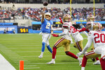 Los Angeles Chargers quarterback Easton Stick (2) throws a touchdown pass to Josh Palmer during the first half of a preseason NFL football game against the San Francisco 49ers Sunday, Aug. 22, 2021, in Inglewood, Calif. (AP Photo/Jae C. Hong)