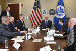 Vice President Mike Pence smiles as he talks with ICE top officials before he receives a briefing at Homeland Security Investigation Principal Field Offices in Atlanta on Thursday, March 21, 2019. (Hyosub Shin/Atlanta Journal-Constitution via AP, Pool)