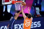 Dallas Mavericks' Josh Reaves (23) and Phoenix Suns' Dario Saric (20) reach for a rebound during the second half of an NBA basketball game Thursday, Aug. 13, 2020 in Lake Buena Vista, Fla. (AP Photo/Ashley Landis, Pool)