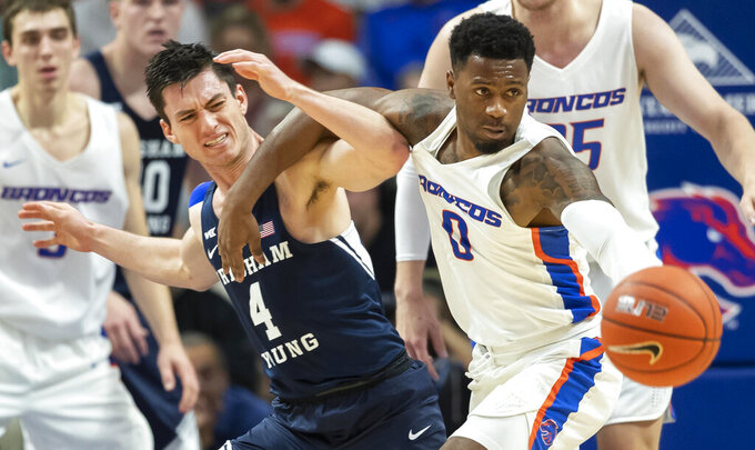 Boise State guard Marcus Dickinson and BYU guard Alex Barcello get tangled on a loose ball in the first half of an NCAA college basketball game Wednesday, Nov. 20, 2019, in Boise. (Darin Oswald/Idaho Statesman via AP)