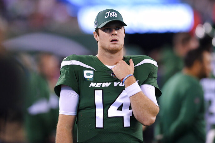 New York Jets quarterback Sam Darnold (14) walks the sideline during the second half of an NFL football game against the New England Patriots, Monday, Oct. 21, 2019, in East Rutherford, N.J. (AP Photo/Bill Kostroun)