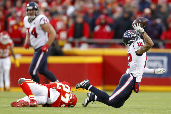 Houston Texans wide receiver Kenny Stills (12) is tripped up by Kansas City Chiefs cornerback Rashad Fenton (27) during a reverse play in the second half of an NFL divisional playoff football game, in Kansas City, Mo., Sunday, Jan. 12, 2020. (AP Photo/Jeff Roberson)