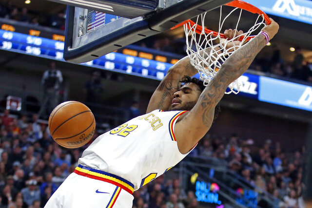 Golden State Warriors forward Marquese Chriss dunks against the Utah Jazz in the first half during an NBA basketball game Friday, Dec. 13, 2019, in Salt Lake City. (AP Photo/Rick Bowmer)