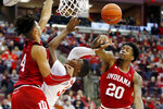 Indiana's De'Ron Davis, right, fouls Ohio State's E.J. Liddell as Trayce Jackson-Davis defends during the second half of an NCAA college basketball game Saturday, Feb. 1, 2020, in Columbus, Ohio. Ohio State beat Indiana 68-59. (AP Photo/Jay LaPrete)