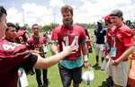 Miami Dolphins quarterback Ryan Fitzpatrick (14) talks with high school students after practice at the team's NFL football training facility, Wednesday, June 5, 2019, in Davie, Fla. (AP Photo/Lynne Sladky)