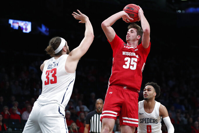 Wisconsin forward Nate Reuvers (35) shooots as Richmond forward Grant Golden (33) defends during the first half of an NCAA college basketball game in the Legends Classic, Monday, Nov. 25, 2019, in New York. (AP Photo/Kathy Willens)