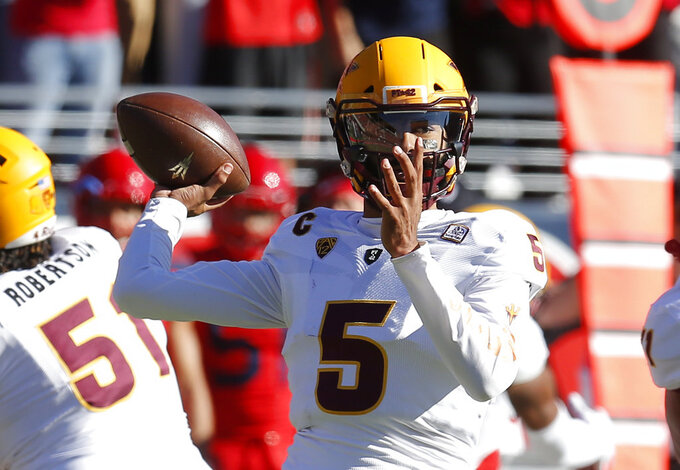 Arizona State quarterback Manny Wilkins (5) throws downfield against Arizona in the first half during an NCAA college football game, Saturday, Nov. 24, 2018, in Tucson, Ariz. (AP Photo/Rick Scuteri)