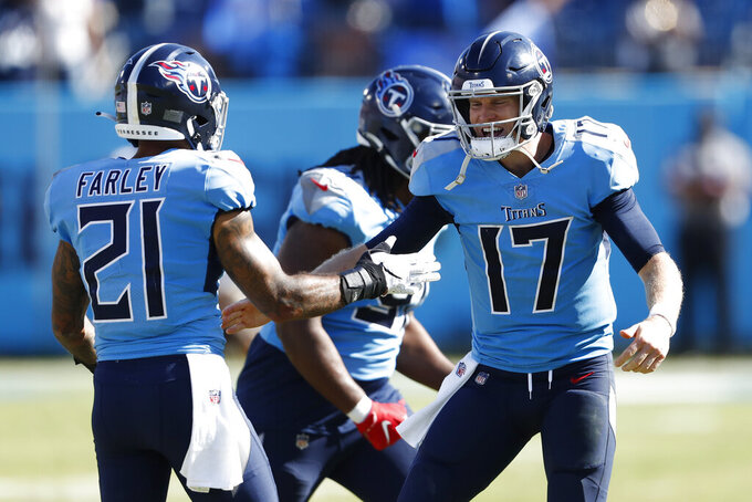 Tennessee Titans quarterback Ryan Tannehill (17) celebrates with defensive back Matthias Farley (21) in the final moments of the fourth quarter during the Titans 25-16 win over the Indianapolis Colts in an NFL football game Sunday, Sept. 26, 2021, in Nashville, Tenn. (AP Photo/Wade Payne)