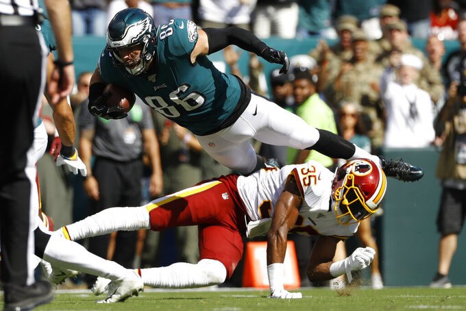 FILE - In this Sept. 8, 2019, file photo, Philadelphia Eagles' Zach Ertz is sent flying after a tackle by Washington Redskins' Montae Nicholson during the second half of an NFL football game, n Philadelphia. The list of injuries has gotten so long for the Philadelphia Eagles that they added a castoff from the lowly Washington Redskins to their roster. Signing wide receiver Robert Davis off the practice squad is just the latest move for the depleted Eagles, who at 6-7 are tied with the Dallas Cowboys atop the NFC East. Missing injured running backs Darren Sproles and Corey Clement as well as receivers DeSean Jackson, Alshon Jeffrey and possibly Nelson Agholor, Philadelphia visits 3-10 Washington on Sunday looking to keep its playoff hopes alive. (AP Photo/Michael Perez, File)