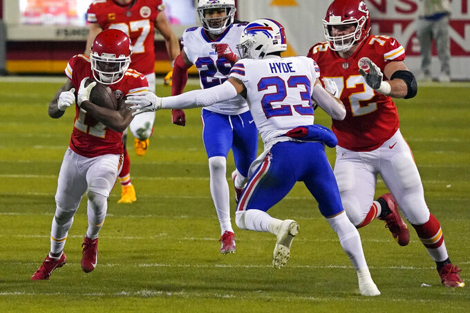 Kansas City Chiefs wide receiver Mecole Hardman (17) runs from Buffalo Bills safety Micah Hyde (23) during the first half of the AFC championship NFL football game, Sunday, Jan. 24, 2021, in Kansas City, Mo. (AP Photo/Jeff Roberson)