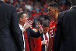 Texas Tech coach Chris Beard talks to TJ Holyfield (22) on the sidelines during the second half of an NCAA college basketball game against Texas, Saturday, Feb. 29, 2020, in Lubbock, Texas. (AP Photo/Brad Tollefson)